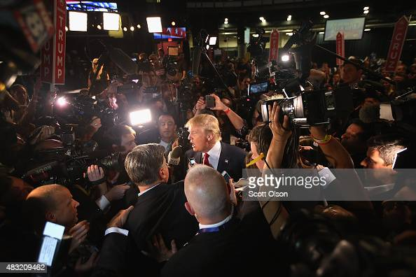Republican presidential candidate Donald Trump talks to reporters in the 'Spin Alley' after the first primetime presidential debate hosted by FOX...