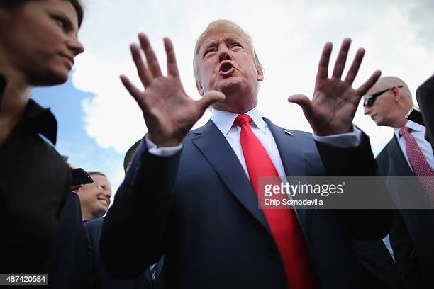 Republican presidential candidate Donald Trump talks with journalists during a rally against the Iran nuclear deal on the West Lawn of the US Capitol...