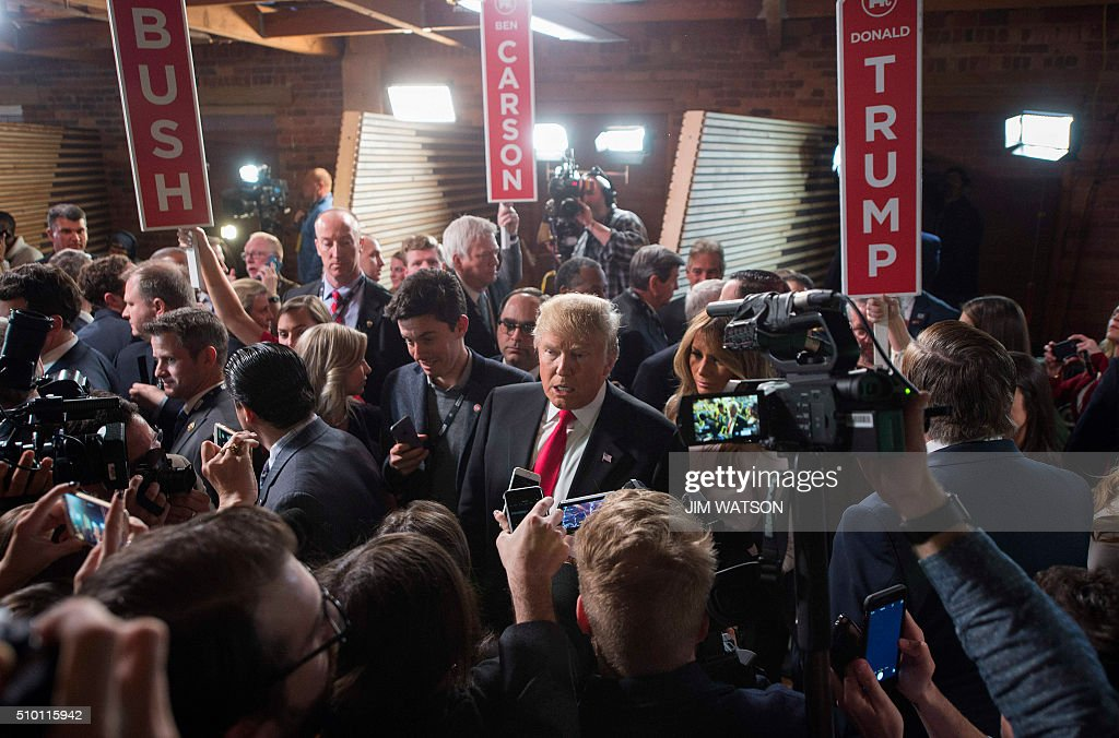 Republican presidential candidate Donald Trump talks with reporters in the Spin Room following the CBS News Republican Presidential Debate in...