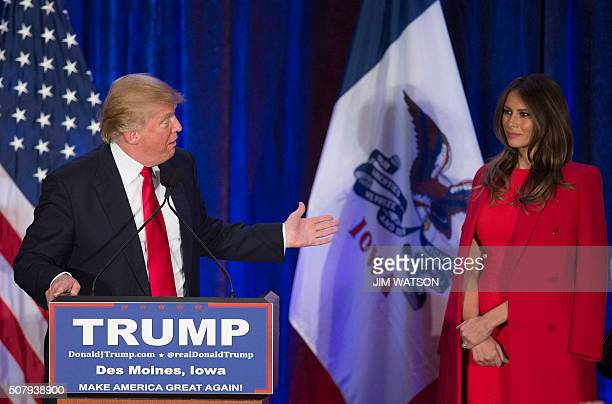 Republican Presidential candidate Donald Trump thanks his wife Melania as he addresses his supporters after finishing second in the Iowa Caucus in...