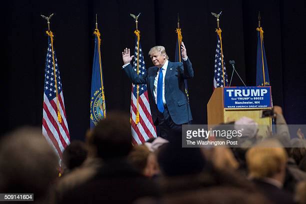 Republican presidential candidate Donald Trump throws up his hands after repeating a non politically correct term a supporter shouted as he speaks at...