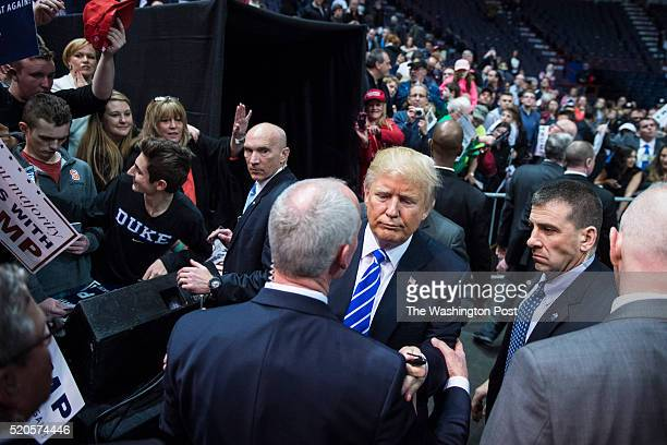 Republican presidential candidate Donald Trump try to get past one of his secret service agents as he greets the crowd after finishes speaking during...