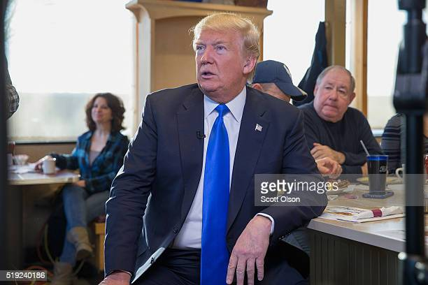 Republican presidential candidate Donald Trump waits to be interviewed by Fox News at a George Webb diner on April 5 2016 in Wauwatosa Wisconsin...