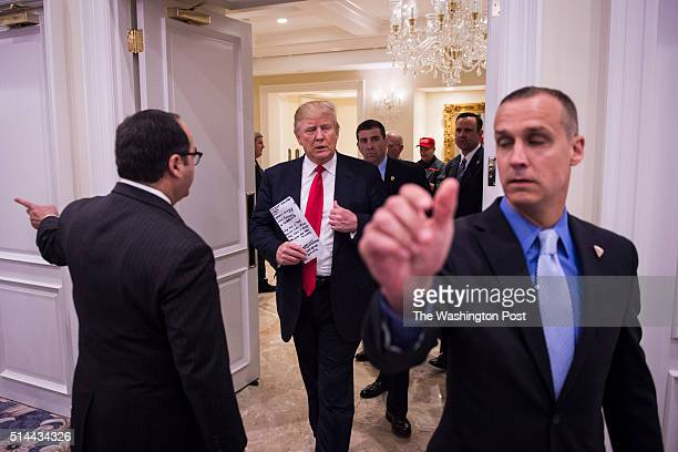 Republican presidential candidate Donald Trump walks in before speaking during a campaign press conference event at the Trump National Golf Club in...