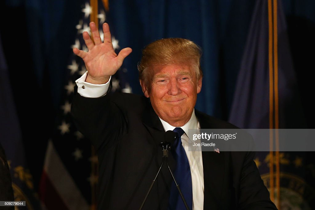 Republican presidential candidate Donald Trump waves to his supporters after Primary day at his election night watch party at the Executive Court Banquet facility on February 9, 2016 in Manchester, New Hampshire. Trump was projected the Republican winner shortly after the polls closed.