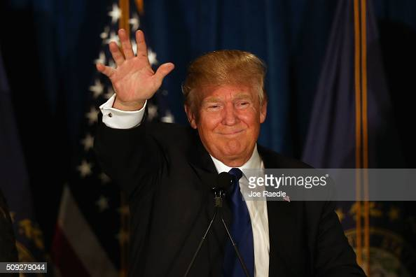 Republican presidential candidate Donald Trump waves to his supporters after Primary day at his election night watch party at the Executive Court...