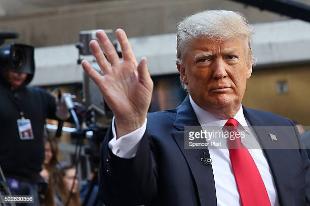 Republican presidential candidate Donald Trump waves to members of the audience while appearing at an NBC Town Hall at the Today Show on April 21...