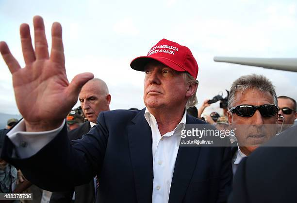 Republican presidential candidate Donald Trump waves to supporters after a campaign rally aboard the USS Iowa on September 15 2015 in Los Angeles...