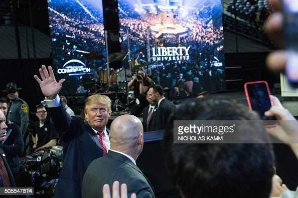 US Republican presidential candidate Donald Trump waves to supporters at a rally at Liberty University in Lynchburg Virginia January 18 2016 / AFP /...