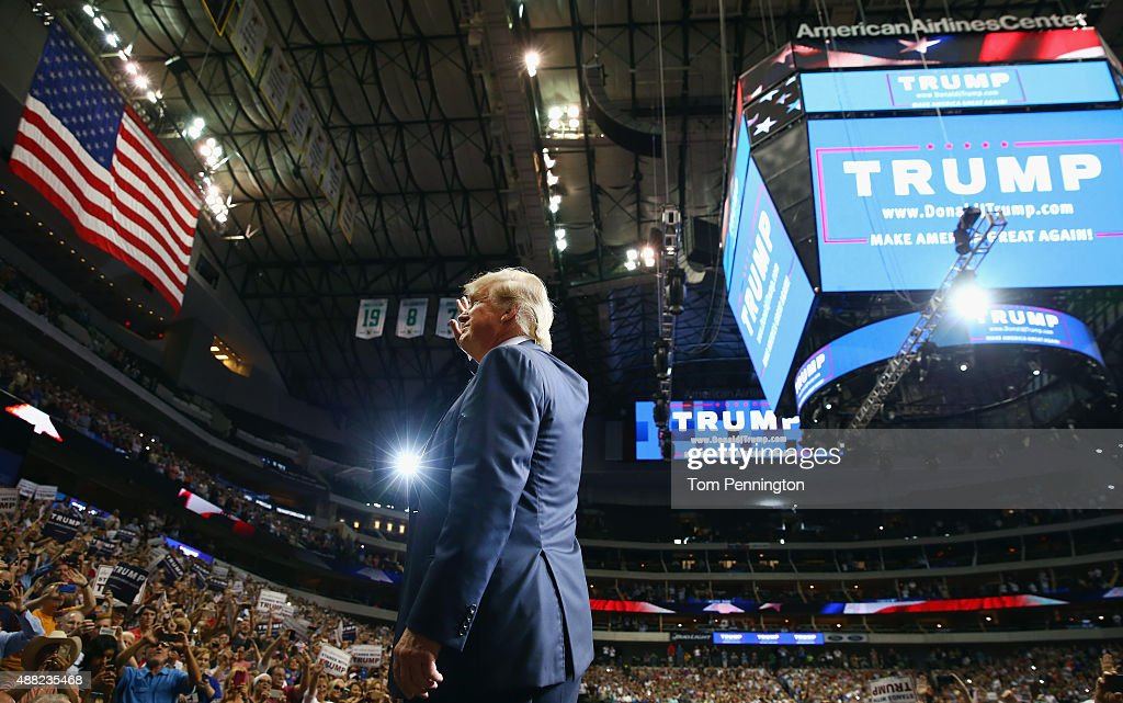 Republican presidential candidate Donald Trump waves to the audience during a campaign rally at the American Airlines Center on September 14, 2015 in Dallas, Texas. More than 20,000 tickets have been distributed for the event.