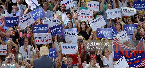 Republican presidential candidate Donald Trump waves to the crowd during a campaign event at Trask Coliseum on August 9 2016 in Wilmington North...