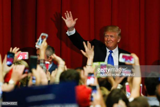 TOPSHOT Republican presidential candidate Donald Trump waves to the crowd at a fundraising event in Lawrenceville New Jersey on May 19 2016 / AFP /...