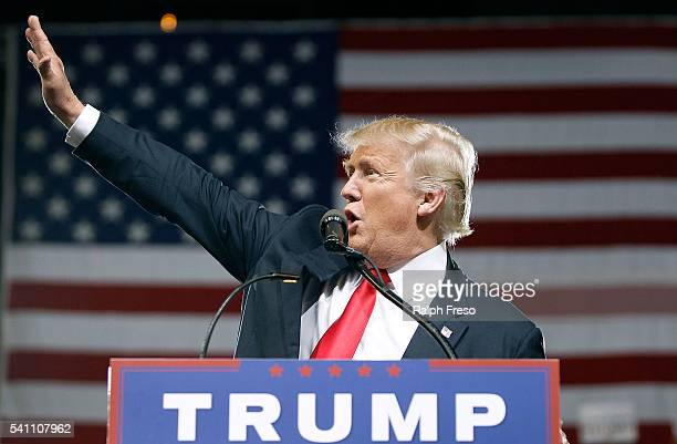 Republican presidential candidate Donald Trump waves to the crowd of supporters during a campaign rally on June 18 2016 in Phoenix Arizona Trump...