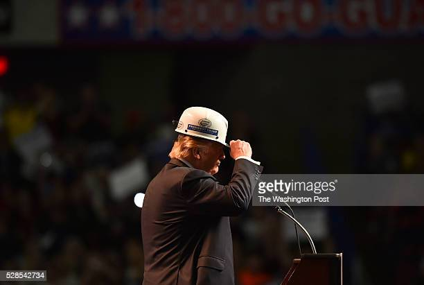 Republican presidential candidate Donald Trump wears a coal miner's protective hat while addressing his supporters during a rally at the Charleston...
