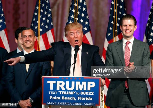 Republican presidential candidate Donald Trump with his son Eric addresses the media following victory in the Florida state primary on March 15 2016...