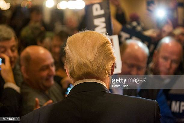 Republican presidential candidate Donald Trump works a rope line after a Town Hall on January 29 2016 in Nashua New Hampshire Trump made a quick stop...