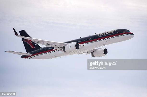 Republican Presidential Candidate Donald Trump's plane flies over a farm as it lands at Dubuque Regional Airport in Dubuque Iowa for a campaign event...