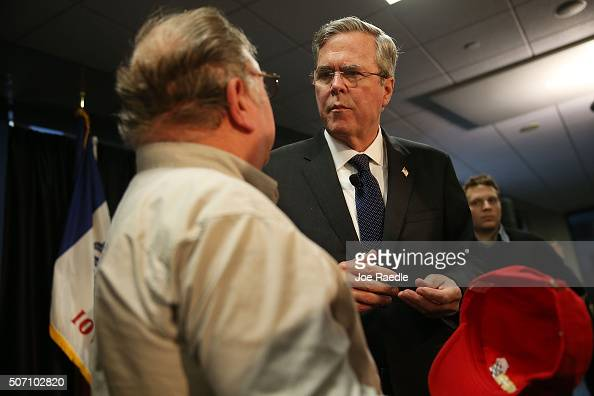 Republican presidential candidate former Florida Governor Jeb Bush greets people during a campaign event at the Nationwide Insurance regional office...