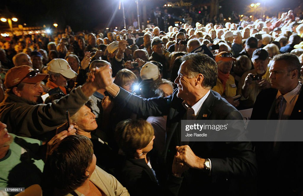 Republican presidential candidate, former Massachusetts Gov. <a gi-track='captionPersonalityLinkClicked' href=/galleries/search?phrase=Mitt+Romney&family=editorial&specificpeople=207106 ng-click='$event.stopPropagation()'>Mitt Romney</a> greets people during a grassroots rally with supporters at Lake Sumter Landing on January 30, 2012 in The Villages, Florida. Romney is campaigning across the state ahead of the January 31 Florida primary.