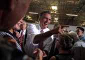 Republican presidential candidate former Massachusetts Gov Mitt Romney greets supporters during a campaign rally at Somers Furniture on May 29 2012...