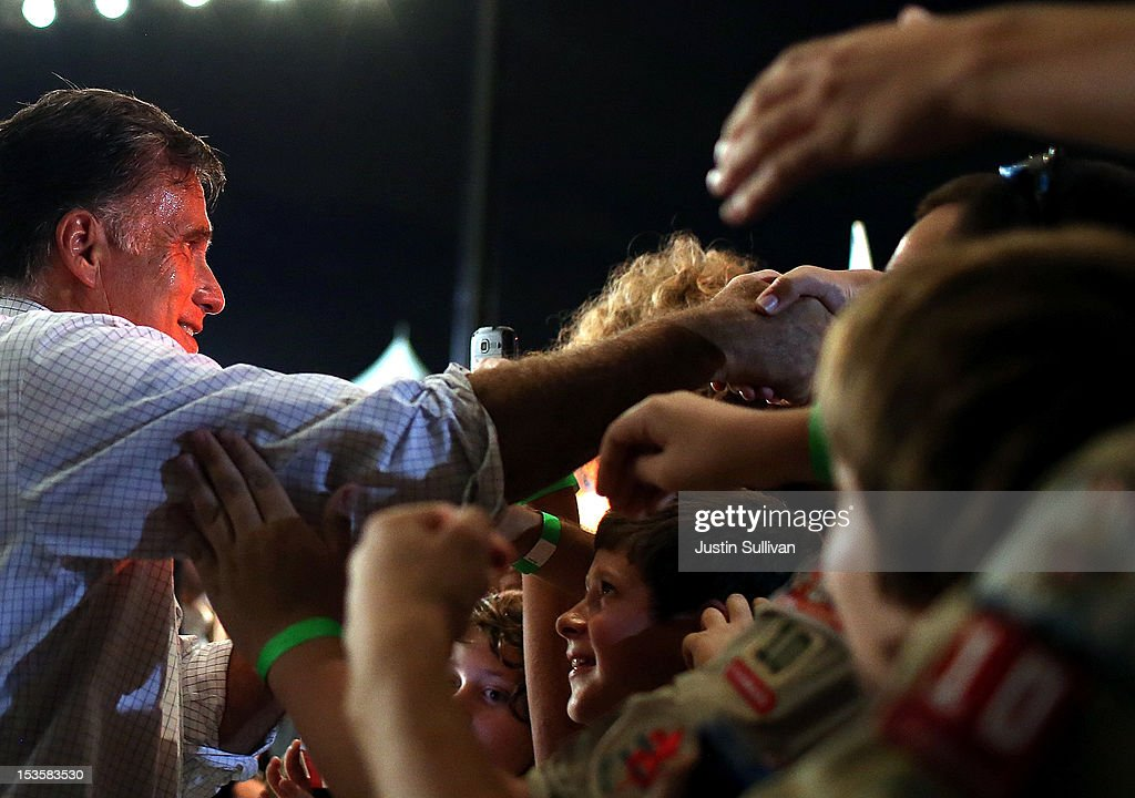 Republican presidential candidate, former Massachusetts Gov. <a gi-track='captionPersonalityLinkClicked' href=/galleries/search?phrase=Mitt+Romney&family=editorial&specificpeople=207106 ng-click='$event.stopPropagation()'>Mitt Romney</a> greets supporters during a campaign rally on October 6, 2012 in Apopka, Florida. <a gi-track='captionPersonalityLinkClicked' href=/galleries/search?phrase=Mitt+Romney&family=editorial&specificpeople=207106 ng-click='$event.stopPropagation()'>Mitt Romney</a> is campaigning in Florida after a visit to the state of Virginia yesterday.