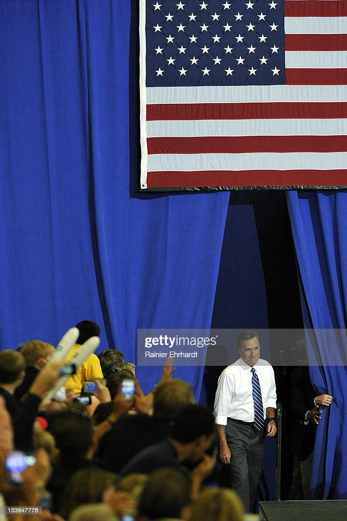 Republican presidential candidate, former Massachusetts Gov. <a gi-track='captionPersonalityLinkClicked' href=/galleries/search?phrase=Mitt+Romney&family=editorial&specificpeople=207106 ng-click='$event.stopPropagation()'>Mitt Romney</a> arrives onstage during a campaign rally on October 11, 2012 in Asheville, North Carolina. Romney is campaigning in North Carolina with less than a month to go before the general election.