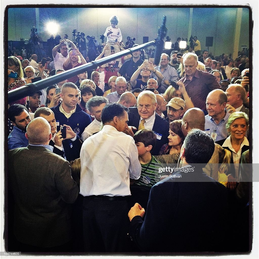 Republican presidential candidate, former Massachusetts Gov. <a gi-track='captionPersonalityLinkClicked' href=/galleries/search?phrase=Mitt+Romney&family=editorial&specificpeople=207106 ng-click='$event.stopPropagation()'>Mitt Romney</a> greets supporters during a campaign rally on October 25, 2012 in Cincinnati, Ohio. <a gi-track='captionPersonalityLinkClicked' href=/galleries/search?phrase=Mitt+Romney&family=editorial&specificpeople=207106 ng-click='$event.stopPropagation()'>Mitt Romney</a> is campaigning in Ohio with less than two weeks to go before the election.