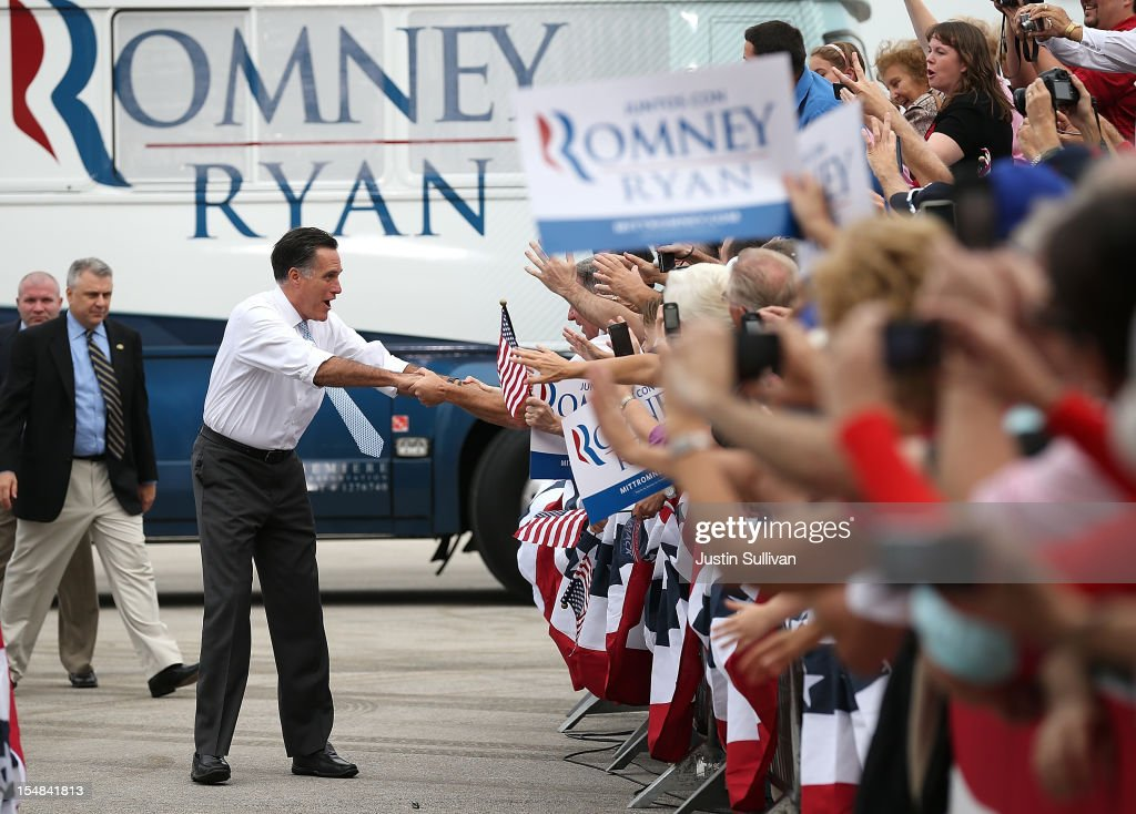 Republican presidential candidate, former Massachusetts Gov. <a gi-track='captionPersonalityLinkClicked' href=/galleries/search?phrase=Mitt+Romney&family=editorial&specificpeople=207106 ng-click='$event.stopPropagation()'>Mitt Romney</a> greets supporters during a campaign rally at Ranger Jet Center on October 27, 2012 in Kissimmee, Florida. With less than two weeks before election day, <a gi-track='captionPersonalityLinkClicked' href=/galleries/search?phrase=Mitt+Romney&family=editorial&specificpeople=207106 ng-click='$event.stopPropagation()'>Mitt Romney</a> is campaigning in Florida.
