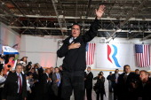 Republican presidential candidate former Massachusetts Gov Mitt Romney greets supporters during a campaign rally at Landmark Aviation on November 5...