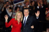 Republican presidential candidate former Massachusetts Gov Mitt Romney and his wife Ann Romney greet supporters during an Illinois GOP primary...