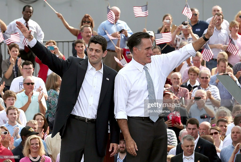 Republican presidential candidate, former Massachusetts Gov. <a gi-track='captionPersonalityLinkClicked' href=/galleries/search?phrase=Mitt+Romney&family=editorial&specificpeople=207106 ng-click='$event.stopPropagation()'>Mitt Romney</a> (R) and U.S. Rep. Paul Ryan (R-WI) wave as Ryan is announced as his vice presidential running mate in front of the USS Wisconsin August 11, 2012 in Norfolk, Virginia. Ryan, a seven term congressman, is Chairman of the House Budget Committee and provides a strong contrast to the Obama administration on fiscal policy.