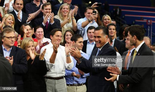 Republican presidential candidate former Massachusetts Gov Mitt Romney and Republican vice presidential candidate US Rep Paul Ryan clap after posing...
