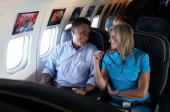Republican presidential candidate former Massachusetts Gov Mitt Romney and his wife Ann Romney talk on the campaign plane on September 1 2012 en...