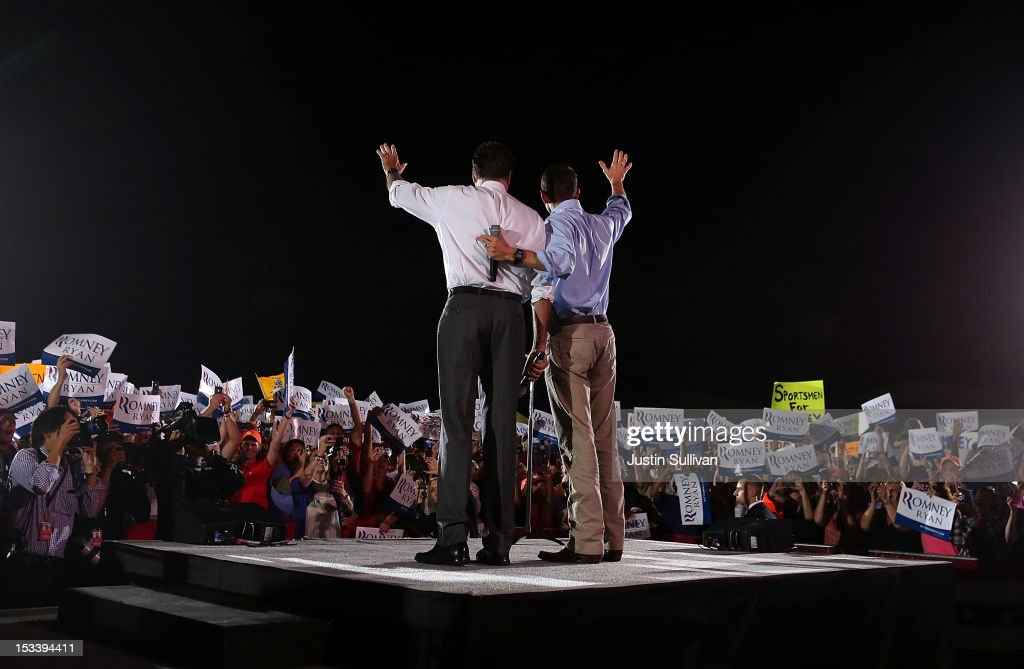 Republican presidential candidate, former Massachusetts Gov. <a gi-track='captionPersonalityLinkClicked' href=/galleries/search?phrase=Mitt+Romney&family=editorial&specificpeople=207106 ng-click='$event.stopPropagation()'>Mitt Romney</a> (L) and his running mate Rep Paul Ryan (R-WI) wave to supporters during a campaign rally at the Augusta Expoland on October 4, 2012 in Fishersville, Virginia. One day after the first Presidential debate, <a gi-track='captionPersonalityLinkClicked' href=/galleries/search?phrase=Mitt+Romney&family=editorial&specificpeople=207106 ng-click='$event.stopPropagation()'>Mitt Romney</a> spoke to the CPAC before heading to Virginia to campaign with his running mate Rep Paul Ryan (R-WI).
