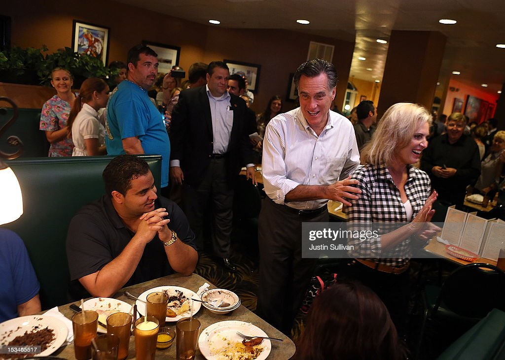 Republican presidential candidate, former Massachusetts Gov. Mitt Romney (L) and his wife Ann Romney (R) greet diners at Capedevila's at La Teresita restaurant on October 5, 2012 in Tampa, Florida. Mitt Romney is campaigning in Virginia coal country and in Florida.