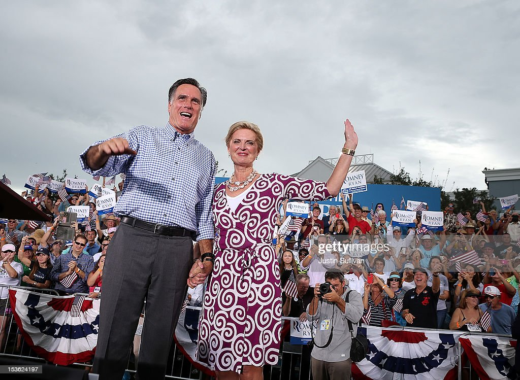 Republican presidential candidate, former Massachusetts Gov. Mitt Romney (L) and his wife Ann Romney wave to supporters during a rally at Tradition Town Square on October 7, 2012 in Port St. Lucie, Florida. Mitt Romney is campaigning in Florida before traveling to Virginia where he is scheduled to give a foreign policy speech at the Virginia Military Institute.