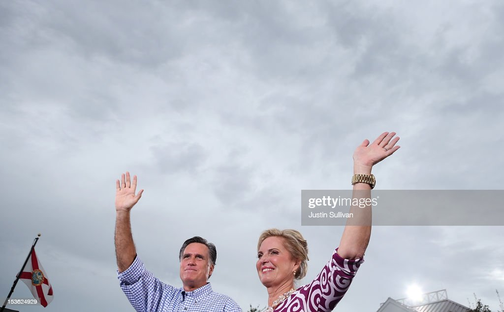 Republican presidential candidate, former Massachusetts Gov. <a gi-track='captionPersonalityLinkClicked' href=/galleries/search?phrase=Mitt+Romney&family=editorial&specificpeople=207106 ng-click='$event.stopPropagation()'>Mitt Romney</a> (L) and his wife <a gi-track='captionPersonalityLinkClicked' href=/galleries/search?phrase=Ann+Romney&family=editorial&specificpeople=868004 ng-click='$event.stopPropagation()'>Ann Romney</a> wave to supporters during a victory rally at Tradition Town Square on October 7, 2012 in Port St. Lucie, Florida. <a gi-track='captionPersonalityLinkClicked' href=/galleries/search?phrase=Mitt+Romney&family=editorial&specificpeople=207106 ng-click='$event.stopPropagation()'>Mitt Romney</a> is campaigning in Florida before traveling to Virginia where he is scheduled to give a foreign policy speech at the Virginia Military Institute.