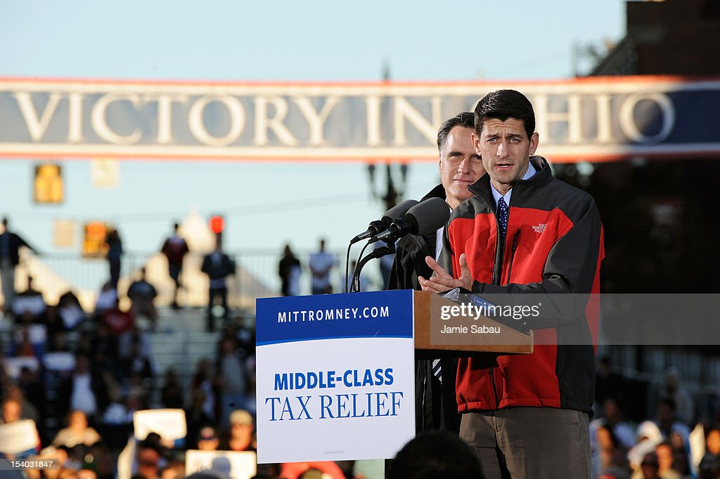 Republican presidential candidate, former Massachusetts Gov. <a gi-track='captionPersonalityLinkClicked' href=/galleries/search?phrase=Mitt+Romney&family=editorial&specificpeople=207106 ng-click='$event.stopPropagation()'>Mitt Romney</a> (L) and Republican vice presidential candidate, U.S. Rep. Paul Ryan (R-WI) speak on stage at a rally on October 12, 2012 in Lancaster, Ohio. The two were campaigning a day after Ryan's debate with U.S. Vice President Joe Biden.