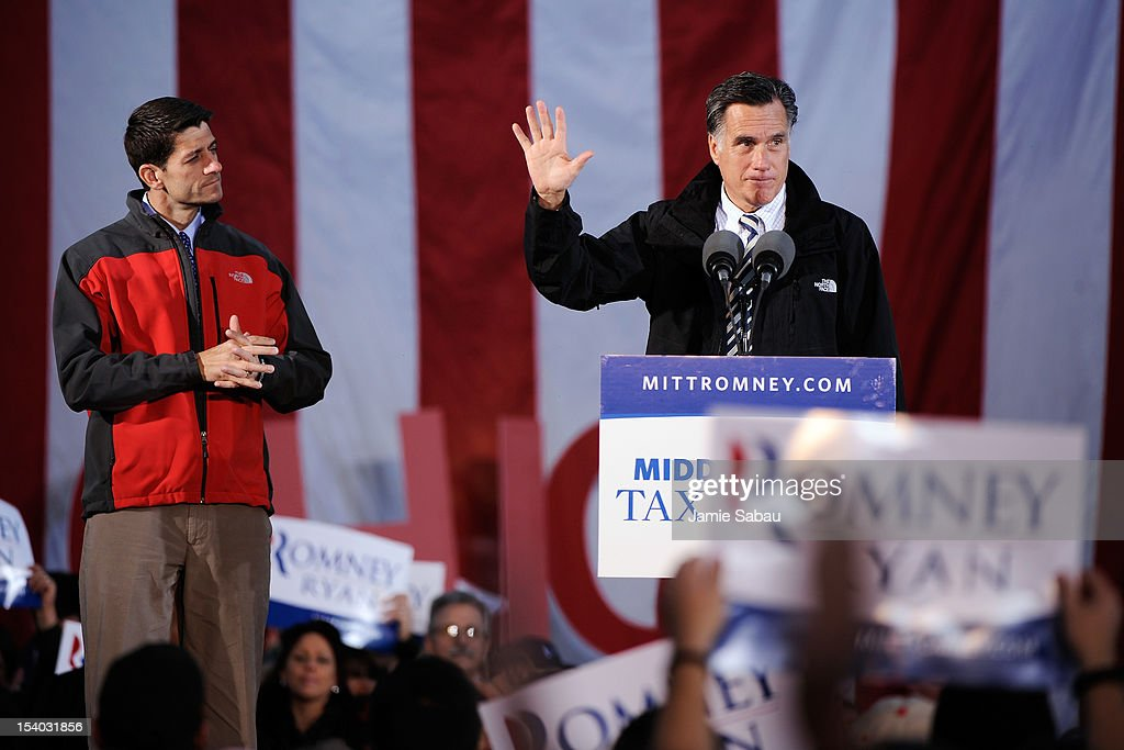 Republican presidential candidate, former Massachusetts Gov. <a gi-track='captionPersonalityLinkClicked' href=/galleries/search?phrase=Mitt+Romney&family=editorial&specificpeople=207106 ng-click='$event.stopPropagation()'>Mitt Romney</a> (R) and Republican vice presidential candidate, U.S. Rep. Paul Ryan (R-WI) speak on stage at a rally on October 12, 2012 in Lancaster, Ohio. The two were campaigning a day after Ryan's debate with U.S. Vice President Joe Biden.