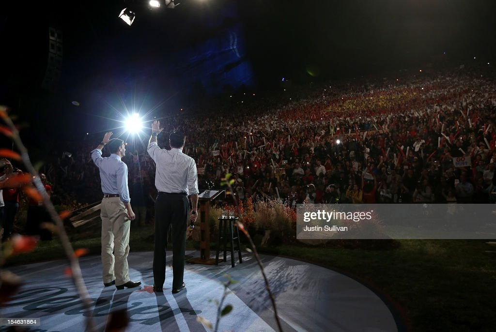Republican presidential candidate, former Massachusetts Gov. <a gi-track='captionPersonalityLinkClicked' href=/galleries/search?phrase=Mitt+Romney&family=editorial&specificpeople=207106 ng-click='$event.stopPropagation()'>Mitt Romney</a> (R) and his running mate Rep. Paul Ryan (R-WI) greet supporters during a campaign rally at the Red Rock Amphitheatre on October 23, 2012 in Morrison, Colorado. A day after the final Presidential debate, <a gi-track='captionPersonalityLinkClicked' href=/galleries/search?phrase=Mitt+Romney&family=editorial&specificpeople=207106 ng-click='$event.stopPropagation()'>Mitt Romney</a> is campaigning in Nevada and Colorado.