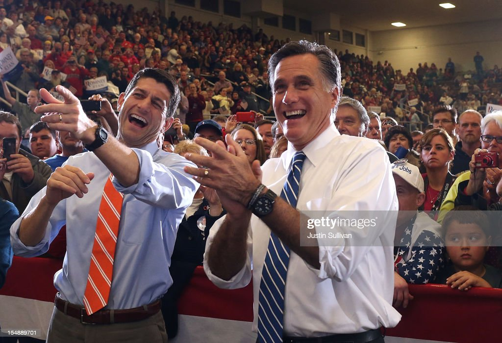 Republican presidential candidate, former Massachusetts Gov. <a gi-track='captionPersonalityLinkClicked' href=/galleries/search?phrase=Mitt+Romney&family=editorial&specificpeople=207106 ng-click='$event.stopPropagation()'>Mitt Romney</a> (R) and his running mate U.S. Sen. Paul Ryan (R-WI) laugh as they watch a performance by the Oakridge Boys during a campaign rally at the Marion County Fairgrounds on October 28, 2012 in Marion, Ohio. With less than two weeks before election day, <a gi-track='captionPersonalityLinkClicked' href=/galleries/search?phrase=Mitt+Romney&family=editorial&specificpeople=207106 ng-click='$event.stopPropagation()'>Mitt Romney</a> is campaigning with Paul Ryan through Ohio.