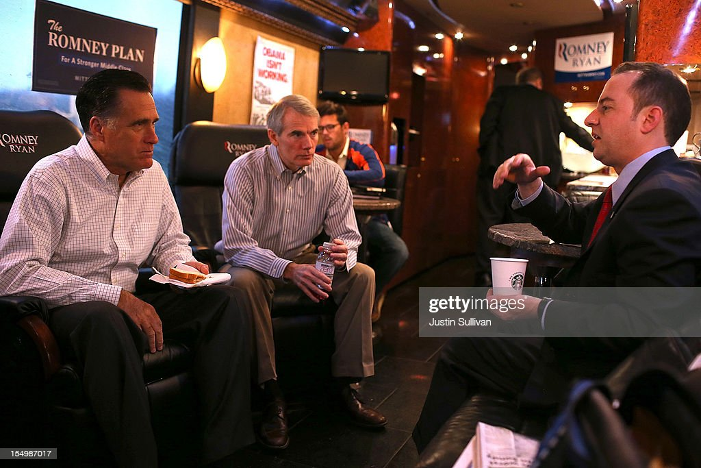 Republican presidential candidate, former Massachusetts Gov. <a gi-track='captionPersonalityLinkClicked' href=/galleries/search?phrase=Mitt+Romney&family=editorial&specificpeople=207106 ng-click='$event.stopPropagation()'>Mitt Romney</a> (L) and campaign advisor U.S. Sen. <a gi-track='captionPersonalityLinkClicked' href=/galleries/search?phrase=Rob+Portman&family=editorial&specificpeople=226973 ng-click='$event.stopPropagation()'>Rob Portman</a> (R-OH) (C) talk with Republican National Committee chairman <a gi-track='captionPersonalityLinkClicked' href=/galleries/search?phrase=Reince+Priebus&family=editorial&specificpeople=7419119 ng-click='$event.stopPropagation()'>Reince Priebus</a> (L) aboard the Romney campaign bus en route to a campaign rally at Avon Lake High School on October 29, 2012 in Avon Lake, Ohio. Romney canceled campaign events on October 29 and 30 due to Hurricane Sandy.