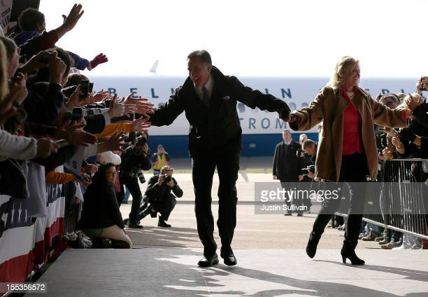 Republican presidential candidate former Massachusetts Gov Mitt Romney and his wife Ann Romney greet supporters during a campaign rally at Dubuque...