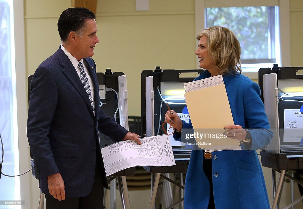 Republican presidential candidate, former Massachusetts Gov. <a gi-track='captionPersonalityLinkClicked' href=/galleries/search?phrase=Mitt+Romney&family=editorial&specificpeople=207106 ng-click='$event.stopPropagation()'>Mitt Romney</a> (L) and his wife <a gi-track='captionPersonalityLinkClicked' href=/galleries/search?phrase=Ann+Romney&family=editorial&specificpeople=868004 ng-click='$event.stopPropagation()'>Ann Romney</a> talk after filling out their ballots at Beech Street Center on November 6, 2012 in Belmont, Massachusetts. The race for the presidency remains tight as Americans are heading to the polls to cast their ballots.