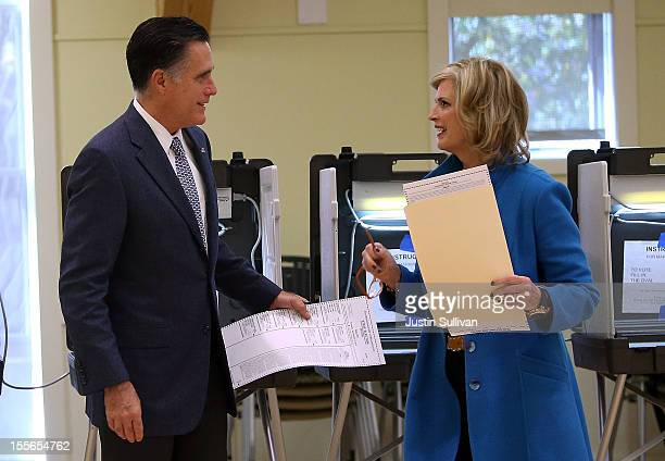 Republican presidential candidate former Massachusetts Gov Mitt Romney and his wife Ann Romney talk after filling out their ballots at Beech Street...