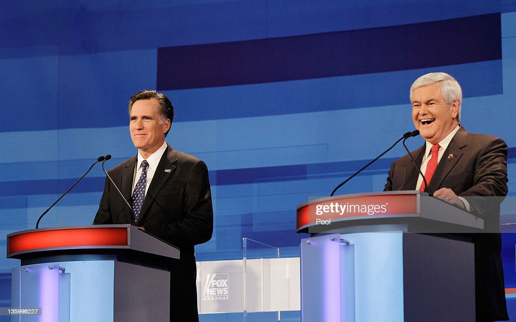 Republican presidential candidate, former Massachusetts Gov. Mitt Romney, speaks as former House Speaker Newt Gingrich, looks on during a Republican presidential debate at the Sioux City Convention Center on December 15, 2011 in Sioux City, Iowa. The GOP contenders are in the final stretch of campaigning in Iowa where the January 3rd caucus is the first test the candidates must face before becoming the Republican presidential nominee.