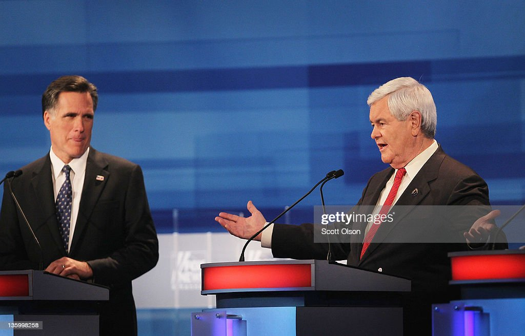 Republican presidential candidate former Massachusetts Gov. Mitt Romney (L), listens as former Speaker of the House Newt Gingrich answers a question during the Fox News Channel debate at the Sioux City Convention Center on December 15, 2011 in Sioux City, Iowa. The GOP contenders are in the final stretch of campaigning in Iowa where the January 3rd caucus is the first test the candidates must face before becoming the Republican presidential nominee.