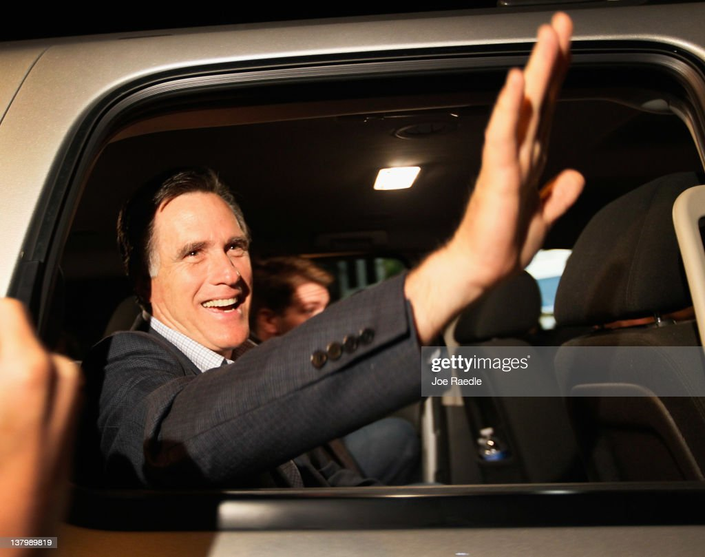 Republican presidential candidate, former Massachusetts Gov. <a gi-track='captionPersonalityLinkClicked' href=/galleries/search?phrase=Mitt+Romney&family=editorial&specificpeople=207106 ng-click='$event.stopPropagation()'>Mitt Romney</a> waves as he rides away in his vehicle after a grassroots rally with supporters at Lake Sumter Landing on January 30, 2012 in The Villages, Florida. Romney is campaigning across the state ahead of the January 31 Florida primary.