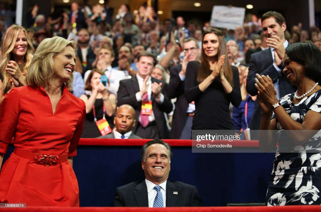 Republican presidential candidate, former Massachusetts Gov. Mitt Romney watches as his wife, Ann Romney and former U.S. Secretary of State Condoleezza Rice stand and applaud during the Republican National Convention at the Tampa Bay Times Forum on August 28, 2012 in Tampa, Florida. Today is the first full session of the RNC after the start was delayed due to Tropical Storm Isaac.