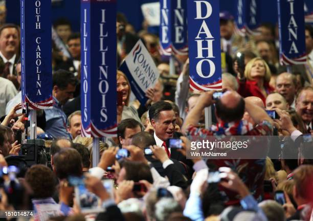 Republican presidential candidate former Massachusetts Gov Mitt Romney greets supporters as he enters during the final day of the Republican National...